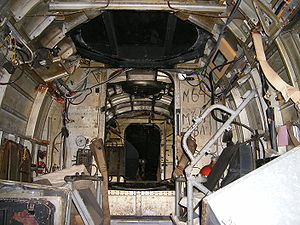 Heinkel He 111 - Inside Wk Nr 701152 He 111 H-20. Looking forward to the first bulkhead from the ventral gunner's position. The control column and cockpit glazing is visible in the central background.