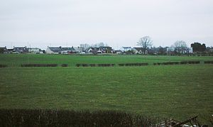 Helenton Loch - A view over the loch site and of the hamlet of Whitelees.