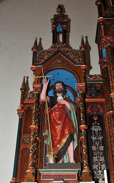 Statu vum Jang den Deefer um Héichaltor an der Kierch zu Hiefenech.