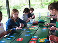Homeschoolers playing Dutch Blitz at picnic gathering.jpg