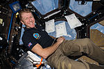 ISS-46 Timothy Peake with Space Seeds in the Cupola.jpg