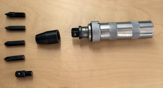 Impact driver - A manual impact driver with screwdriver bits and adapters