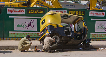 Auto rickshaw being repaired, Bangalore - Auto rickshaw