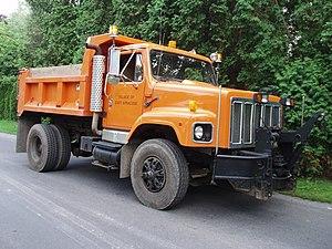 East Syracuse, New York - Village International DPW Plow truck at work site.
