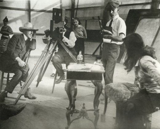 Left to right: Griffith, cameraman Billy Bitzer (behind Pathe camera), Dorothy Gish watching from behind Bitzer, Karl Brown keeping script, and Miriam Cooper in profile, in a production still for Intolerance (1916). Intolerance production 1916.jpg