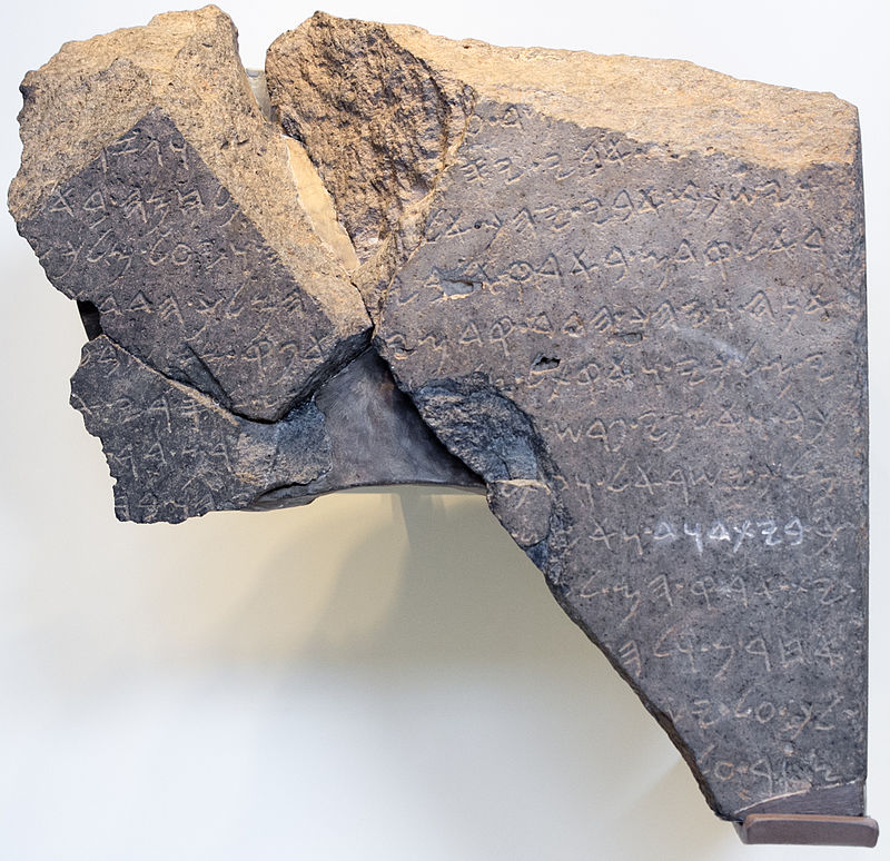 rock inscribed with ancient alphabet