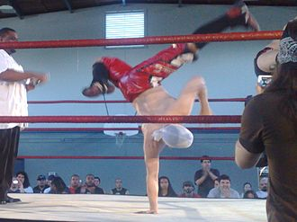 Jack Evans (wrestler) - Evans breakdancing in the ring.