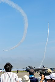 Japan air self defense force Kawasaki T-4 Blue Impulse RJSM Low Angle Cuban and Roll On Take Off.jpg