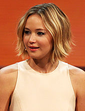Jennifer Lawrence is smiling away from the camera.