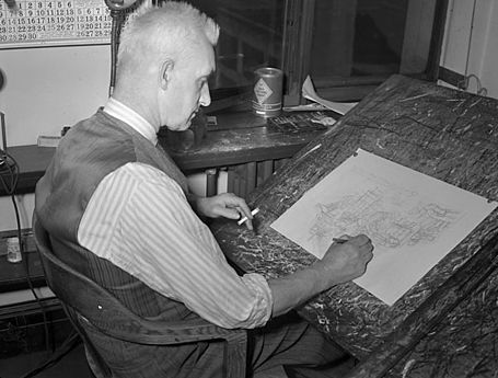 Black-and-white photo of a man drawing