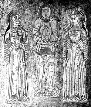 John Basset (1462–1528) - Monumental brasses of Sir John Basset (1462–1529) with his two wives, right: first wife Elizabeth Denys, left: second wife Honor Grenville. Detail from top slab of his chest-tomb, Atherington Church, Devon