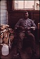 John Hoskin, Jr., an Ex-Miner with Black Lung Disease, Lives in Rhodell, West Virginia, near Beckley. He Worked in the Mines for 15 Years; Now He Likes to Sit on His Porch and Drink Whiskey (3906443951).jpg