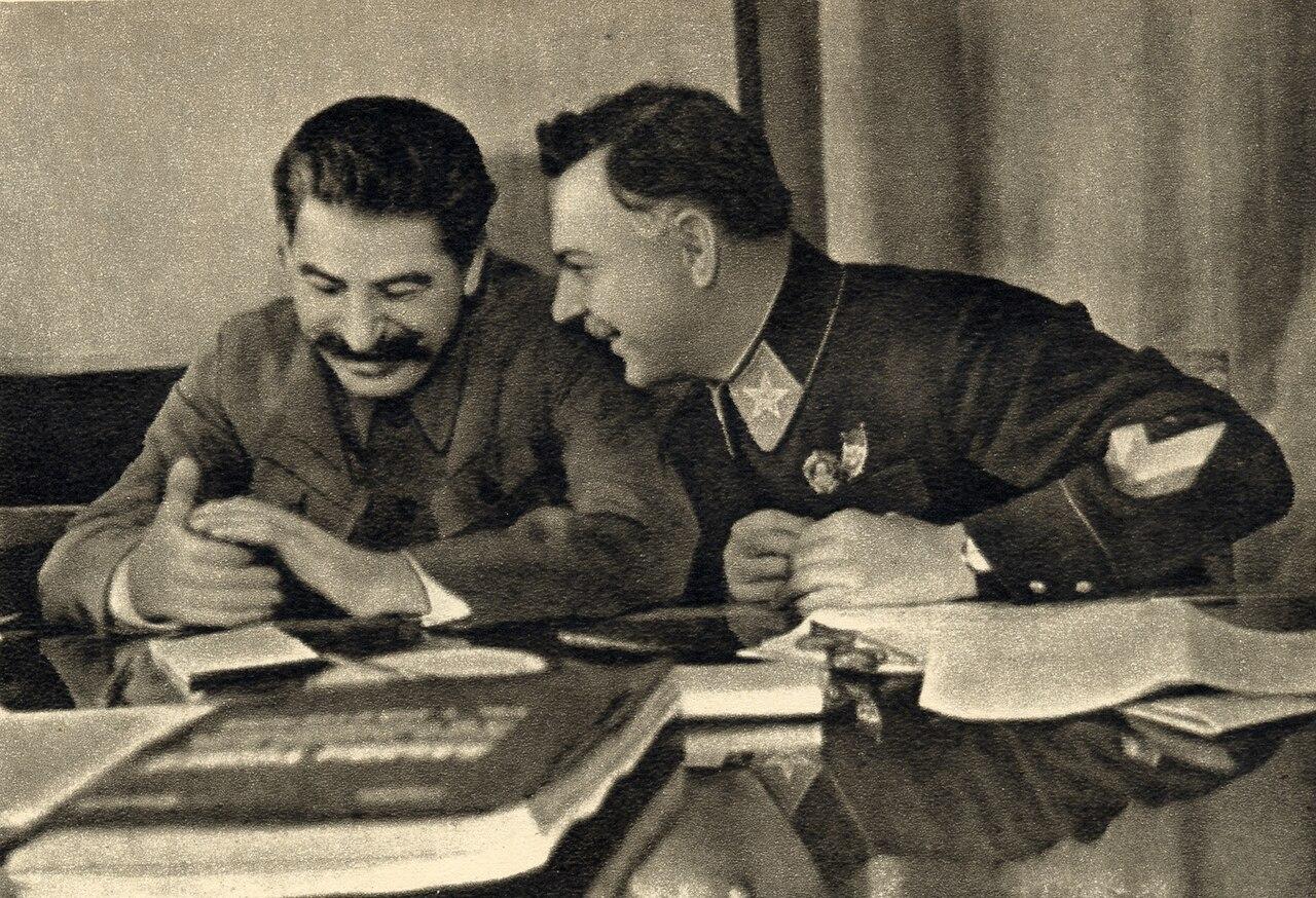 1280px-Joseph_Stalin_and_Kliment_Voroshilov%2C_1935.jpg