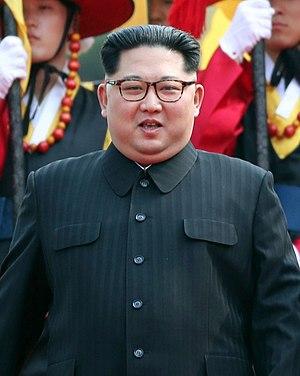 Kim Jong Un with Honor Guard portrait.jpg