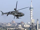 A U.S. Army helicopter flying by Baghdad's tower