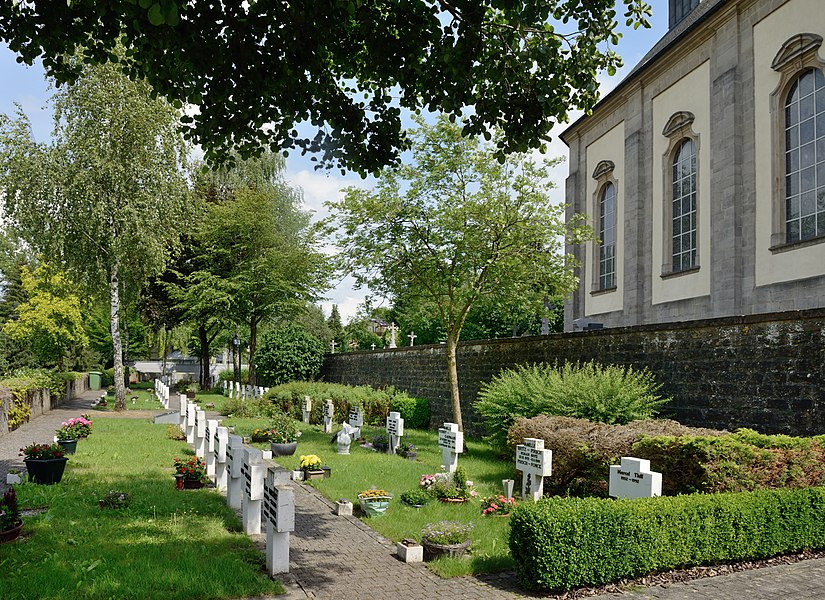 Koerich, Luxembourg: part of the 'new' cemetery close to the village church (at right).