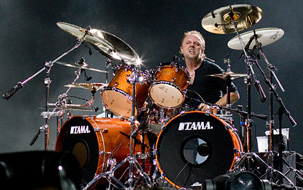Lars Ulrich (pictured in 2008) founded Metallica through an advertisement in The Recycler. He picked the band's name from his friend Ron Quintana's list of names for his upcoming magazine. Ulrich suggested Metal Mania, secretly wanting to use Metallica as the band's name. Lars Ulrich live in London 2008-09-15.jpg