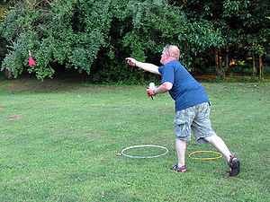 Lawn darts - A man throwing lawn darts