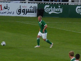 Liam Lawrence - Lawrence playing for Republic of Ireland against Algeria in a 2010 friendly