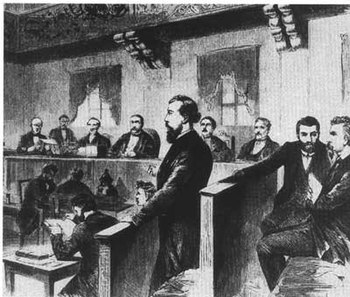 August Bebel (first from right) and Wilhelm Liebknecht (standing in the middle) are convicted of high treason in Leipzig because of their opposition to the Franco-German War