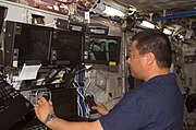 Leroy Chiao working on Space Station Remote Manipulator System