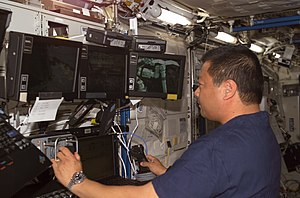 Leroy Chiao - Astronaut Leroy Chiao works with the controls of the Canadarm2
