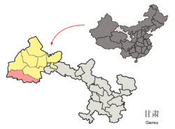 Location of Aksay Kazak Autonomous County (pink) within Jiuquan City (yellow), Gansu Province (light grey) and the People's Republic of China (dark grey)