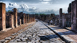 Curb - Stone curbs and raised sidewalks on both sides of a 2000-year-old paved road in Pompeii, Italy