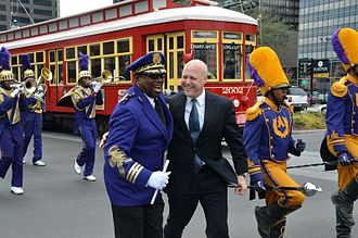 Rampart–St. Claude Streetcar Line - Mayor Mitch Landrieu with the St. Augustine Purple Knights Marching Band at opening celebrations for the new Loyola Avenue streetcar line on January 28, 2013.