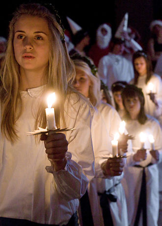 Church attendance - A Swedish Christian girl leads a church procession on Saint Lucy's Day