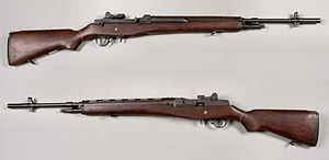 An M14 rifle without a magazine shown from the right and left sides