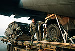 M998 High-Mobility Multipurpose Wheeled Vehicles (HMMWV) are loaded from a K-loader into a C-130E Hercules aircraft for sequential heavy airdrop practice by the 37th Tactical Airlift Squadron DF-ST-90-09814.jpg