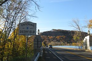 Massachusetts Route 116 - Entering Deerfield crossing the Sunderland Bridge westbound with Sugarloaf Mountain in the background