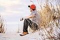 Man sitting on sand (Unsplash).jpg