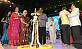 Mega Actor Rajnikanth lighting the lamp at the inauguration of the 45th International Film Festival of India (IFFI-2014), in Panaji, Goa. The Governor of Goa, Smt. Mridula Sinha, the Chief Minister of Goa.jpg