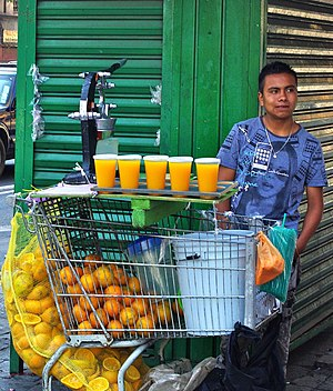 Orange juice - Mexico City merchant with his freshly squeezed orange juice, March 2010