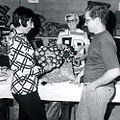 Michiana Mennonite Relief Sale- Lamar Hubert Looks over a Pillow,circa 1973 (14814754918).jpg
