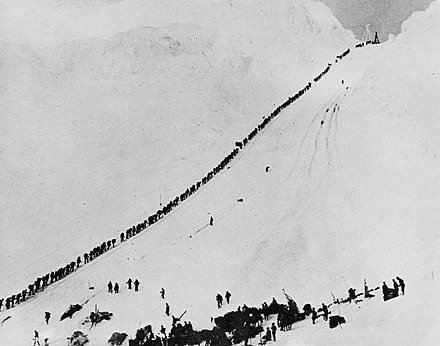 Miners and prospectors climb the Chilkoot Trail during the 1898 Klondike Gold Rush Miners climb Chilkoot.jpg