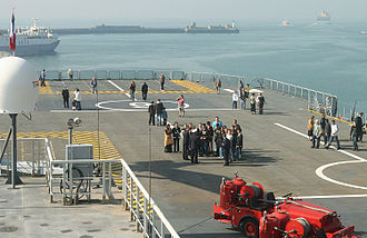 Mistral-class amphibious assault ship - The flight deck of Mistral as seen from the island superstructure. Both lifts can be seen: the main lift at the rear of the ship, and the auxiliary lift on the extreme left of frame.