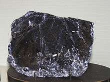 Dark reflective crystal of molybdenite
