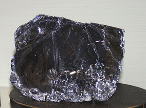 Molybdenite - A sample of molybdenite mineral less pure than the single-crystal specimen above.