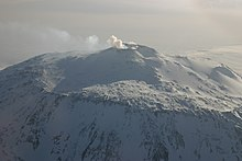 Distant view of a mountain with a smoke emission from its summit