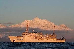 NOAAS Fairweather (S 220) - NOAAS Fairweather (S 220) in Alaskan waters with Mount Fairweather in the background.