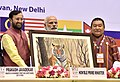 Narendra Modi being presented the memento by the Minister of State for Environment, Forest and Climate Change (Independent Charge), Shri Prakash Javadekar, at the 3rd Asia Ministerial Conference on Tiger Conservation.jpg