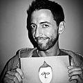 Neal Brennan with paper face.jpg