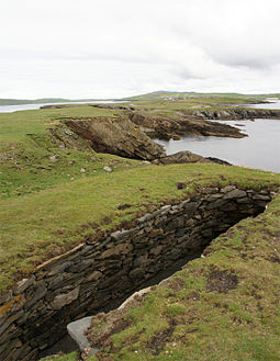 Northern part of the Ness looking inland towards Scatness.  The structure in the foreground is part of the Ness of Burgi fort