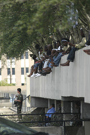 Effect of Hurricane Katrina on the Louisiana Superdome - People wait outside the Superdome, August 31.