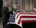 Newsman Tom Brokaw places his hand on the casket of former President Gerald Ford.jpg