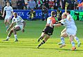 Nick Evans about to be tackled by Geraghty (13507927035).jpg