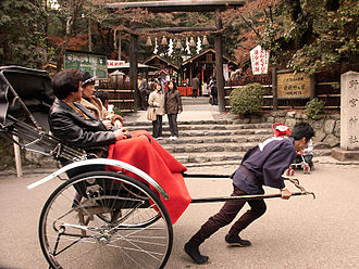 Gratuity - A rickshaw operator pulls two guests near Kyoto